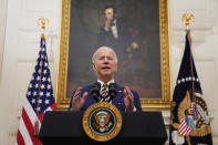 President Joe Biden delivers remarks on the economy in the State Dining Room of the White House, Friday, Jan. 22, 2021, in Washington. (AP Photo/Evan Vucci)