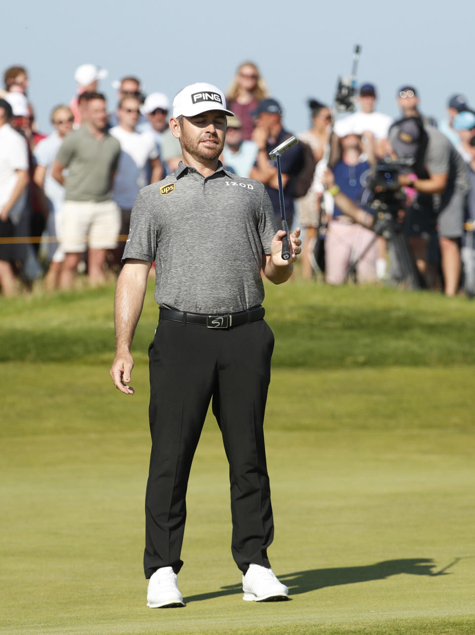 South Africa's Louis Oosthuizen reacts on the 10th green after missing a putt during the final round of the British Open Golf Championship at Royal St George's golf course Sandwich, England, Sunday, July 18, 2021. (AP Photo/Peter Morrison)