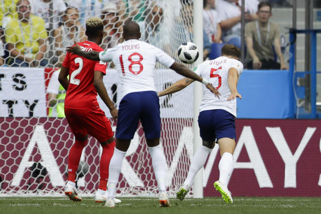 England's John Stones, right, scores his side's opening goal during the group G match between England and Panama at the 2018 soccer World Cup at the Nizhny Novgorod Stadium in Nizhny Novgorod , Russia, Sunday, June 24, 2018. (AP Photo/Alastair Grant)