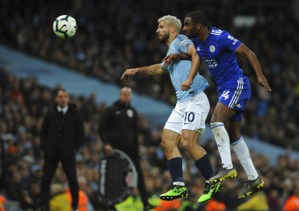 Manchester City's Sergio Aguero struggles for the ball against Leicester City's Ricardo Perriera during their match.
