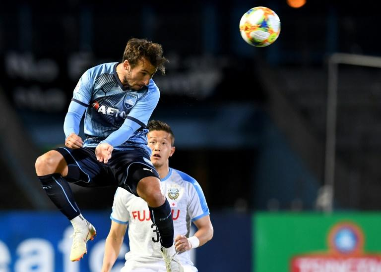 Sydney FC's Adam le Fondre displayed his enduring predatory instincts to keep Shanghai SIPG at bay