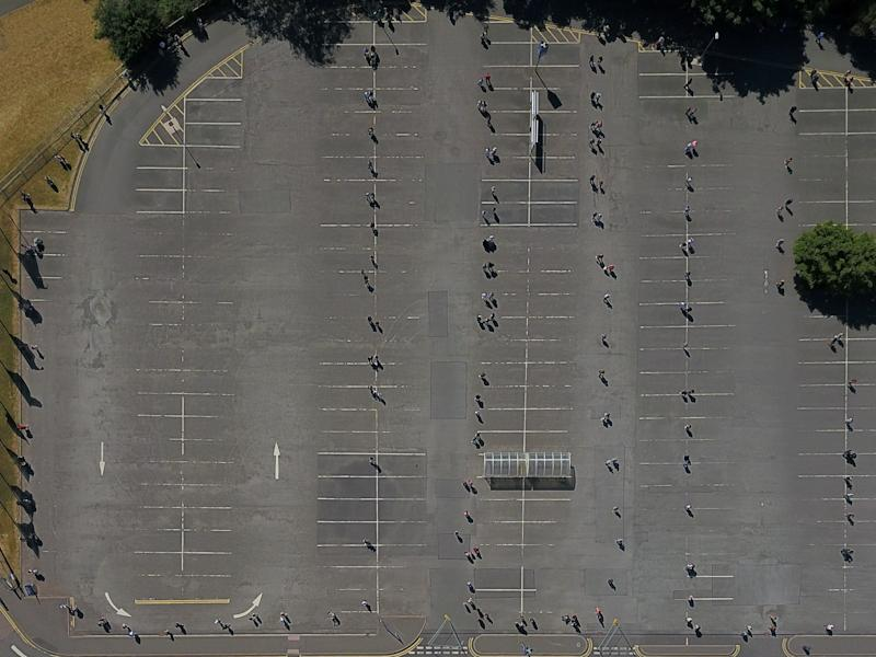 Aerial view of shoppers waiting to get inside the Wednesbury Ikea. (SWNS)