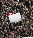 Protesters chant slogans against President Zine El Abidine Ben Ali in Tunis, Friday, Jan. 14, 2011. Some thousands of angry demonstrators marched through the Tunisian capital Friday, demanding the resignation of the country's autocratic leader a day after he appeared on TV to try to stop deadly riots that have swept the North African nation. On Thursday Jan. 14, 2021, Tunisia commemorates 10 years since the flight into exile of its iron-fisted leader, Zine El Abidine Ben Ali, pushed from power in a popular revolt that foreshadowed the so-called Arab Spring. (AP Photo/Christophe Ena)
