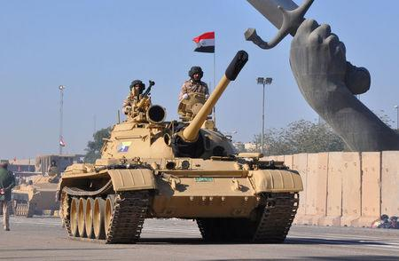 Tanks of Iraqi army are seen during an Iraqi military parade in Baghdad's fortified Green Zone