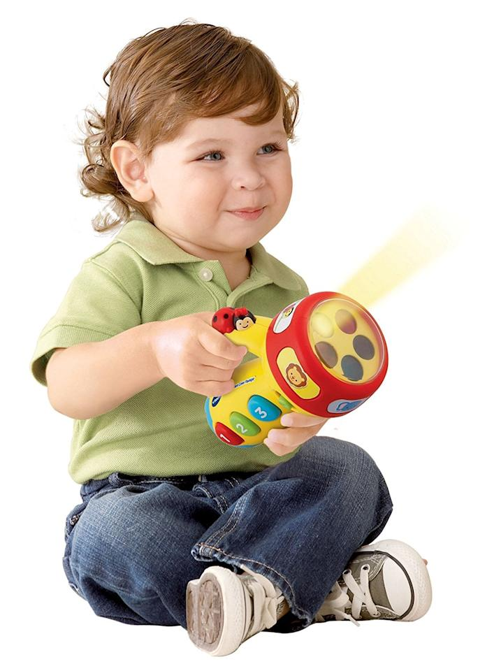 """<p>This <a href=""""https://www.popsugar.com/buy/VTech-Spin-Learn-Color-Flashlight-329356?p_name=VTech%20Spin%20and%20Learn%20Color%20Flashlight&retailer=amazon.com&pid=329356&price=10&evar1=moms%3Aus&evar9=25800161&evar98=https%3A%2F%2Fwww.popsugar.com%2Fphoto-gallery%2F25800161%2Fimage%2F44870227%2FVTech-Spin-Learn-Color-Flashlight&list1=gifts%2Choliday%2Cgift%20guide%2Cparenting%2Ckid%20shopping%2Choliday%20for%20kids%2Cgifts%20for%20toddlers%2Cbest%20of%202019&prop13=api&pdata=1"""" rel=""""nofollow"""" data-shoppable-link=""""1"""" target=""""_blank"""" class=""""ga-track"""" data-ga-category=""""Related"""" data-ga-label=""""https://www.amazon.com/VTech-Spin-Learn-Color-Flashlight/dp/B007XVYPS2/ref=sr_1_6?ie=UTF8&amp;qid=1527008675&amp;sr=8-6&amp;keywords=toys+for+2+year+olds&amp;dpID=41VIWXNBCSL&amp;preST=_SX300_QL70_&amp;dpSrc=srch"""" data-ga-action=""""In-Line Links"""">VTech Spin and Learn Color Flashlight</a> ($10) comes with over 50 sing-along songs, music, sounds, and fun phrases.</p>"""