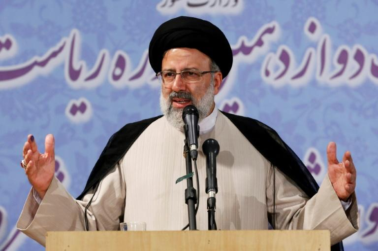 Iranian cleric Ebrahim Raisi delivers a speech after registering his candidacy for the upcoming presidential elections in the capital Tehran on April 14, 2017