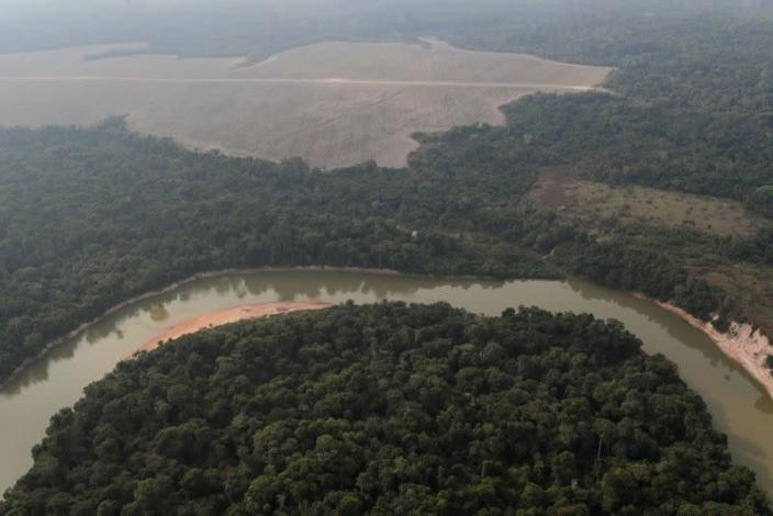 FILE PHOTO: An aerial view shows a river and a deforested plot of the Amazon near Porto Velho