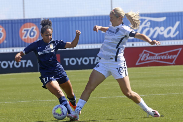 North Carolina Courage defender Addisyn Merrick (27) battles for the ball with Portland Thorns FC midfielder Lindsey Horan (10) during the first half of an NWSL Challenge Cup soccer match at Zions Bank Stadium Saturday, June 27, 2020, in Herriman, Utah. (AP Photo/Rick Bowmer)