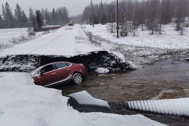 A driver in Saint-Philippe, N.B., crashed into a ditch after a culvert washed out. (Submitted by Venessa Cormier - image credit)