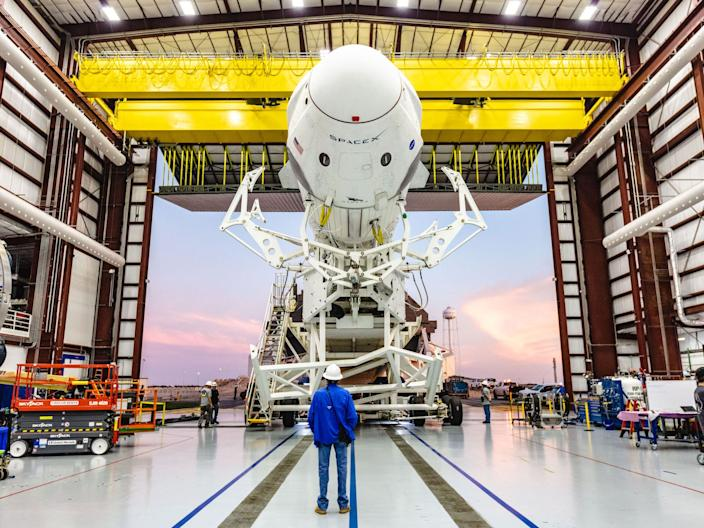 A SpaceX Falcon 9 rocket with Crew Dragon attached rolls out of the hangar at NASA Kennedy Space Center's Launch Complex 39A on January 3, 2019.