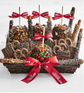 """<p>simplychocolate.com</p><p><strong>$69.99</strong></p><p><a href=""""https://go.redirectingat.com?id=74968X1596630&url=https%3A%2F%2Fwww.simplychocolate.com%2Fsimply-chocolate-deluxe-christmas-cravings-basket-163274&sref=https%3A%2F%2Fwww.thepioneerwoman.com%2Fholidays-celebrations%2Fgifts%2Fg37433020%2Ffood-gift-baskets%2F"""" rel=""""nofollow noopener"""" target=""""_blank"""" data-ylk=""""slk:Shop Now"""" class=""""link rapid-noclick-resp"""">Shop Now</a></p><p>This one is sure to please anyone with a sweet tooth! The caramel pretzel rods, caramel apples, and chocolate-covered grahams are hand-dipped and decorated daily for guaranteed freshness. </p>"""