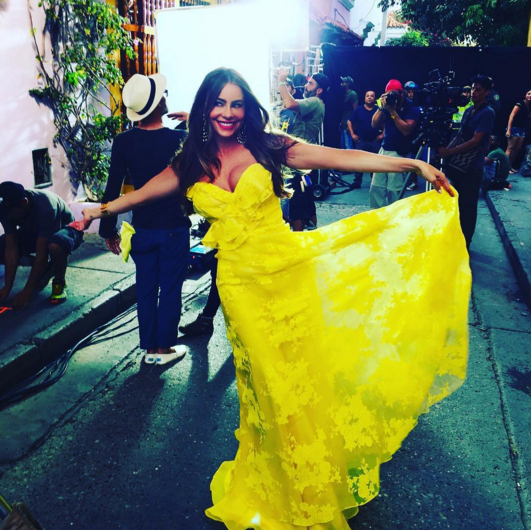 "Umm. Wow. Vergara no-doubt had jaws dropping when she stepped on out set in a bright yellow lace gown. Based on her glowing smile, she knew just how good she looked. ""On the set,"" she declared. (Photo: Instagram)"