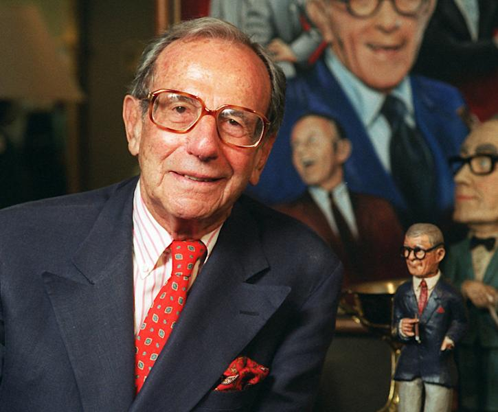 """FILE - This Oct. 6, 1996 file photo shows Irving Fein, long time manager of the late George Burns, standing near memorabilia up for auction at Sotheby's, in Beverly Hills, Calif. Fein, a producer and manager who steered the careers of George Burns and Jack Benny and nicknamed actress Lana Turner """"the Sweater Girl,"""" died Aug. 10, 2012 of an age-related illness. He was 101. (AP Photo/Frank Wiese, file)"""