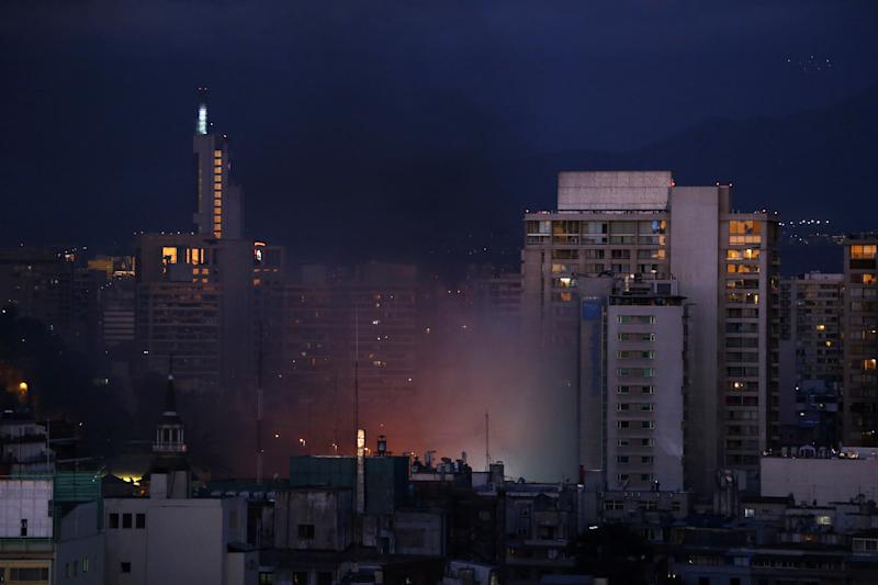 Smoke is seen from a burning shopping mall during an anti-government protest in Santiago, Chile on Oct. 28, 2019. (Photo: Ivan Alvarado/Reuters)