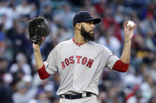Boston Red Sox starting pitcher David Price calls for a new ball after giving up two hits to the Seattle Mariners during the fifth inning of a baseball game Thursday, June 14, 2018, in Seattle. (AP Photo/Elaine Thompson)