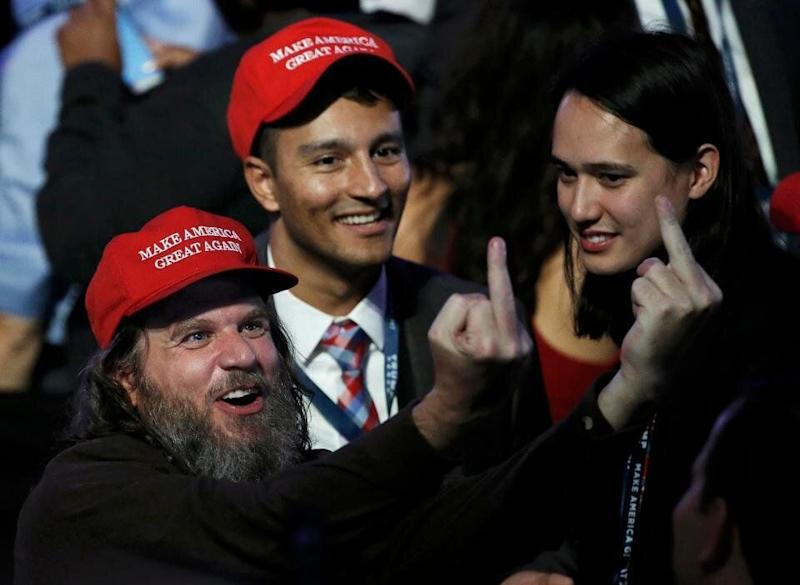 Far-right extremist Pax Dickinson celebrates Donald Trump's election in 2016 with Hoan Ton-That in New York City. (Photo: REUTERS/Mike Segar)