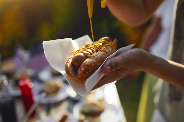 """<p>According to the National Hot Dog and Sausage Council, approximately <a href=""""http://www.hot-dog.org/media/consumption-stats"""" rel=""""nofollow noopener"""" target=""""_blank"""" data-ylk=""""slk:150 million hot dogs are consumed by Americans"""" class=""""link rapid-noclick-resp"""">150 million hot dogs are consumed by Americans</a> on the 4th of July each year. If lined up, that amount of hot dogs could stretch from Washington D.C. to Los Angeles more than five times. </p>"""