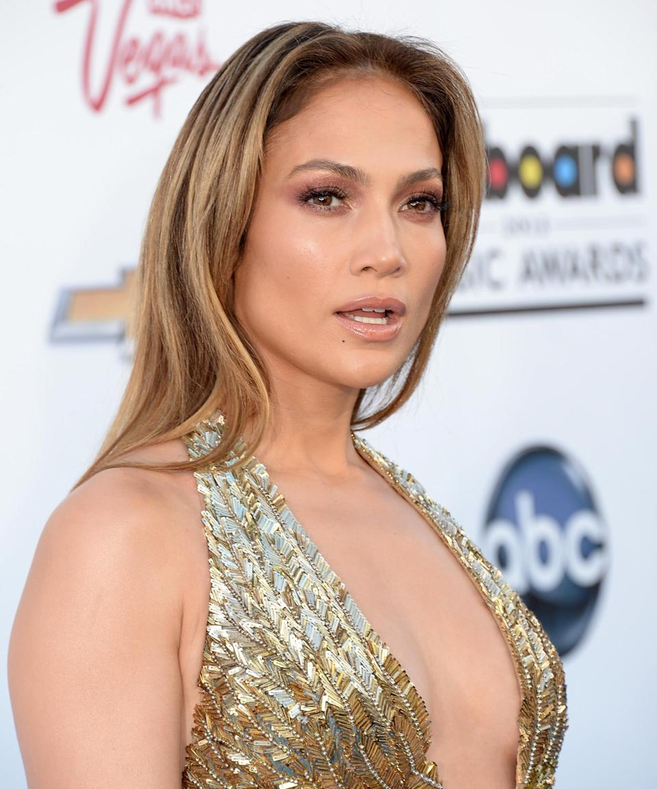 """<h3>2013</h3><br>For the 2013 Billboard Music Awards, J.Lo walked the carpet with her signature blonde hair slicked back, subtle contoured cheekbones, and a wash of mauve eyeshadow worthy of a chef's kiss.<span class=""""copyright"""">Photo: Jason Merritt/Getty Images.</span>"""