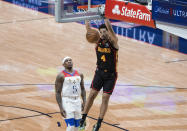 Atlanta Hawks guard Skylar Mays (4) dunks past New Orleans Pelicans guard Eric Bledsoe (5) in the second quarter of an NBA basketball game in New Orleans, Friday, April 2, 2021. (AP Photo/Derick Hingle)