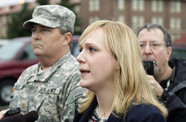Emma Scanlan, right, the civilian defense attorney for U.S. Army Staff Sgt. Robert Bales, talks to reporters, Tuesday Nov. 13, 2012, as she stands with Bales' military defense attorney, Maj. Gregory Malson, left, on Joint Base Lewis McChord in Washington state, where a preliminary hearing ended Tuesday for Bales, who is accused of 16 counts of premeditated murder and six counts of attempted murder for a pre-dawn attack on two villages in Kandahar Province in Afghanistan last March. (AP Photo/Ted S. Warren)