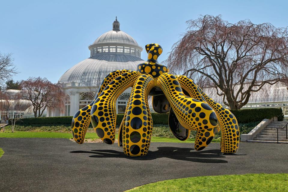 Kusama's Dancing Pumpkin in front of the Haupt Conservatory