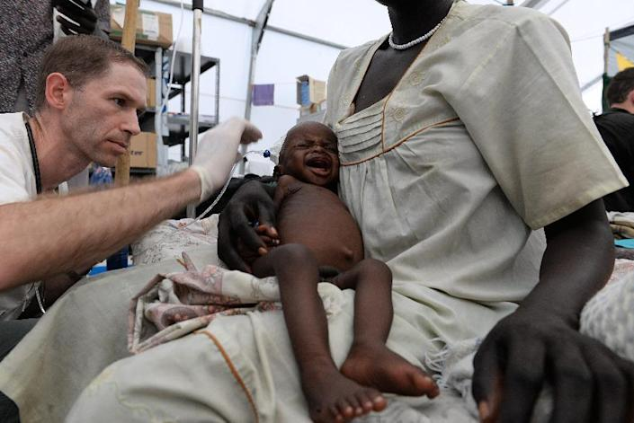 A nine-month-old boy is cared for at a Medecins Sans Frontieres clinic on May 30, 2014 at the United Nations Mission in South Sudan (UNMISS) site in Malakal (AFP Photo/Charles Atiki Lomodong)