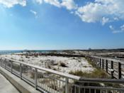 """<p>Between Alabama's two big beach towns – and more importantly, between the Hangout Music Festival and <a href=""""https://www.thrillist.com/drink/nation/bars-and-restaurants-where-you-can-you-drink-in-two-states-at-once-lake-tahoe-hotels-flora-bama"""" rel=""""nofollow noopener"""" target=""""_blank"""" data-ylk=""""slk:Flora-Bama bar"""" class=""""link rapid-noclick-resp"""">Flora-Bama bar</a> – sits a little section of undeveloped coastline set aside for the outdoor enthusiast. Not only does it boast a two-mile stretch of white sand beach that somehow hasn't been overtaken by tourists or weekend partiers, but there's also an 18-hole golf course, <a href=""""https://www.thrillist.com/travel/nation/hunter-mountain-in-ny-and-zip-slide-in-south-africa-are-among-the-world-s-most-insane-ziplines"""" rel=""""nofollow noopener"""" target=""""_blank"""" data-ylk=""""slk:zip line"""" class=""""link rapid-noclick-resp"""">zip line</a>, and a 500-yard pier where you can spend the day fishing. <i>(Photo: <a href=""""https://www.flickr.com/photos/kenspix/8465312811/"""" rel=""""nofollow noopener"""" target=""""_blank"""" data-ylk=""""slk:Flickr/Ken Ratcliff"""" class=""""link rapid-noclick-resp"""">Flickr/Ken Ratcliff</a>)</i></p>"""