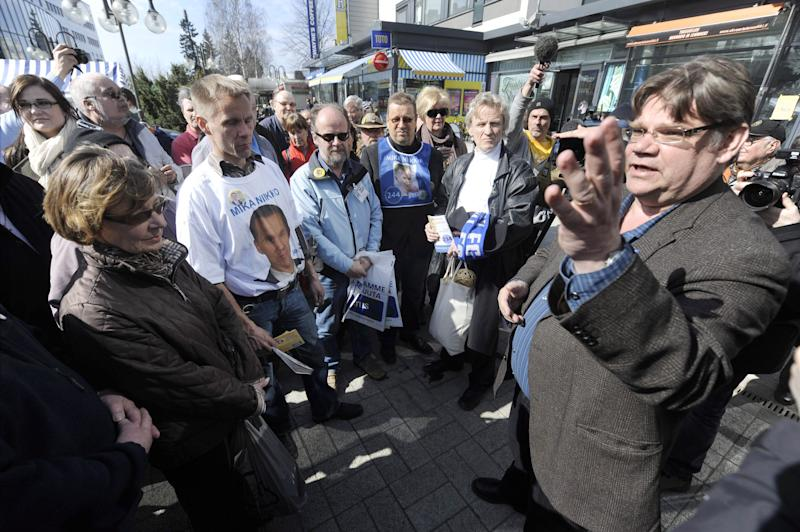 Timo Soini, right,  leader of True Finns and candidate for the Finnish Parliament gestures during the party's election campaign in Vantaa, Finland on  Saturday April 16, 2011. Finns will go to the polls in parliamentary elections  on Sunday. (AP Photo/LEHTIKUVA / Markku Ulander ) FINLAND OUT NO SALES