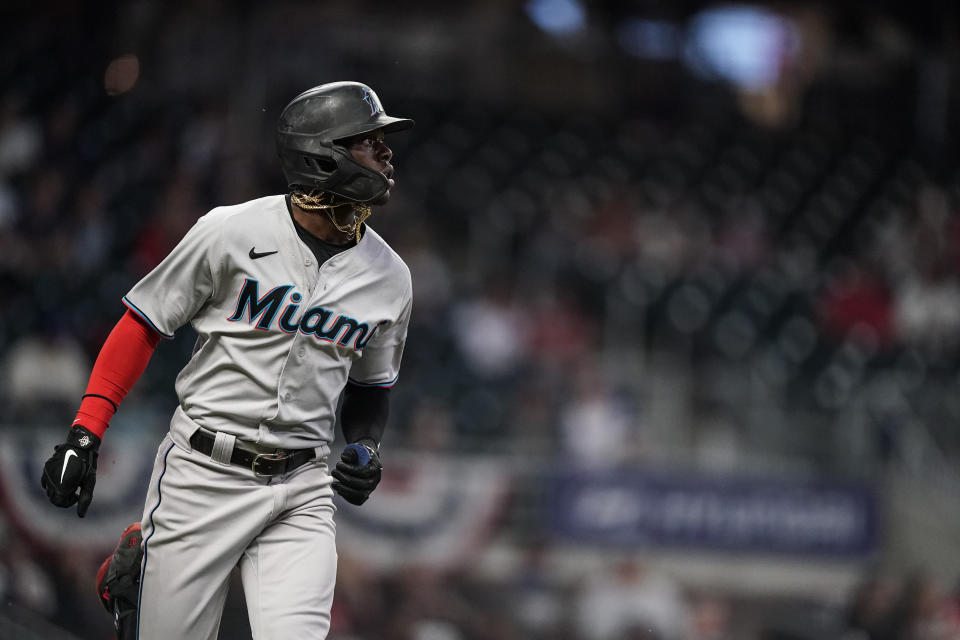 Miami Marlins' Jazz Chisholm Jr. watches his home run during the third inning of the team's baseball game against the Atlanta Braves on Wednesday, April 14, 2021, in Atlanta. (AP Photo/Brynn Anderson)