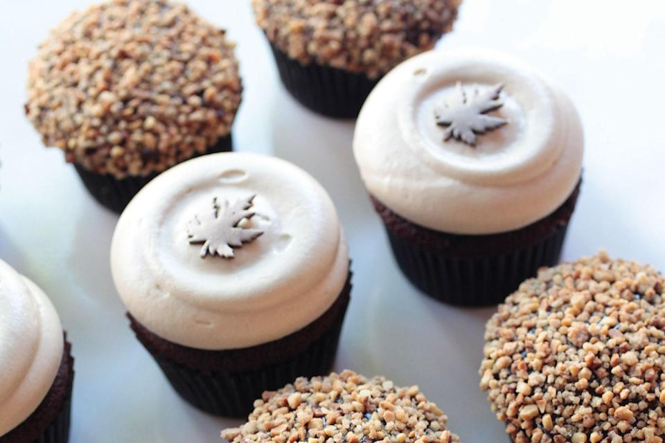"""These pumpkin spice cupcakes are topped with a maple–cream cheese frosting and fondant leaf cutouts decorated with shimmery <a href=""""https://bakell.com/collections/edible-luster-dusts"""" rel=""""nofollow noopener"""" target=""""_blank"""" data-ylk=""""slk:luster dust"""" class=""""link rapid-noclick-resp"""">luster dust</a>. <a href=""""https://www.epicurious.com/recipes/food/views/pumpkin-spice-cupcakes?mbid=synd_yahoo_rss"""" rel=""""nofollow noopener"""" target=""""_blank"""" data-ylk=""""slk:See recipe."""" class=""""link rapid-noclick-resp"""">See recipe.</a>"""