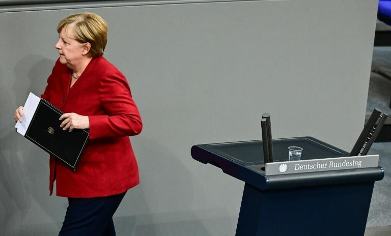 German Chancellor Angela Merkel's legacy is marked by light and shadows (AFP/Tobias SCHWARZ)