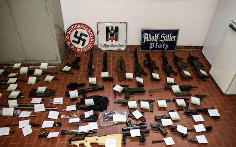 A big cache of guns and ammunition was seized by the Turin special police force - Credit: FRANCESCO AMMENDOLA,HO/AFP/Getty Images
