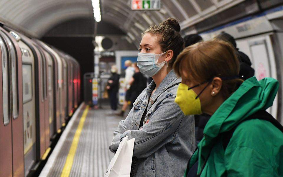 Commuters on the tube in London - Andy Rain/EPA-EFE