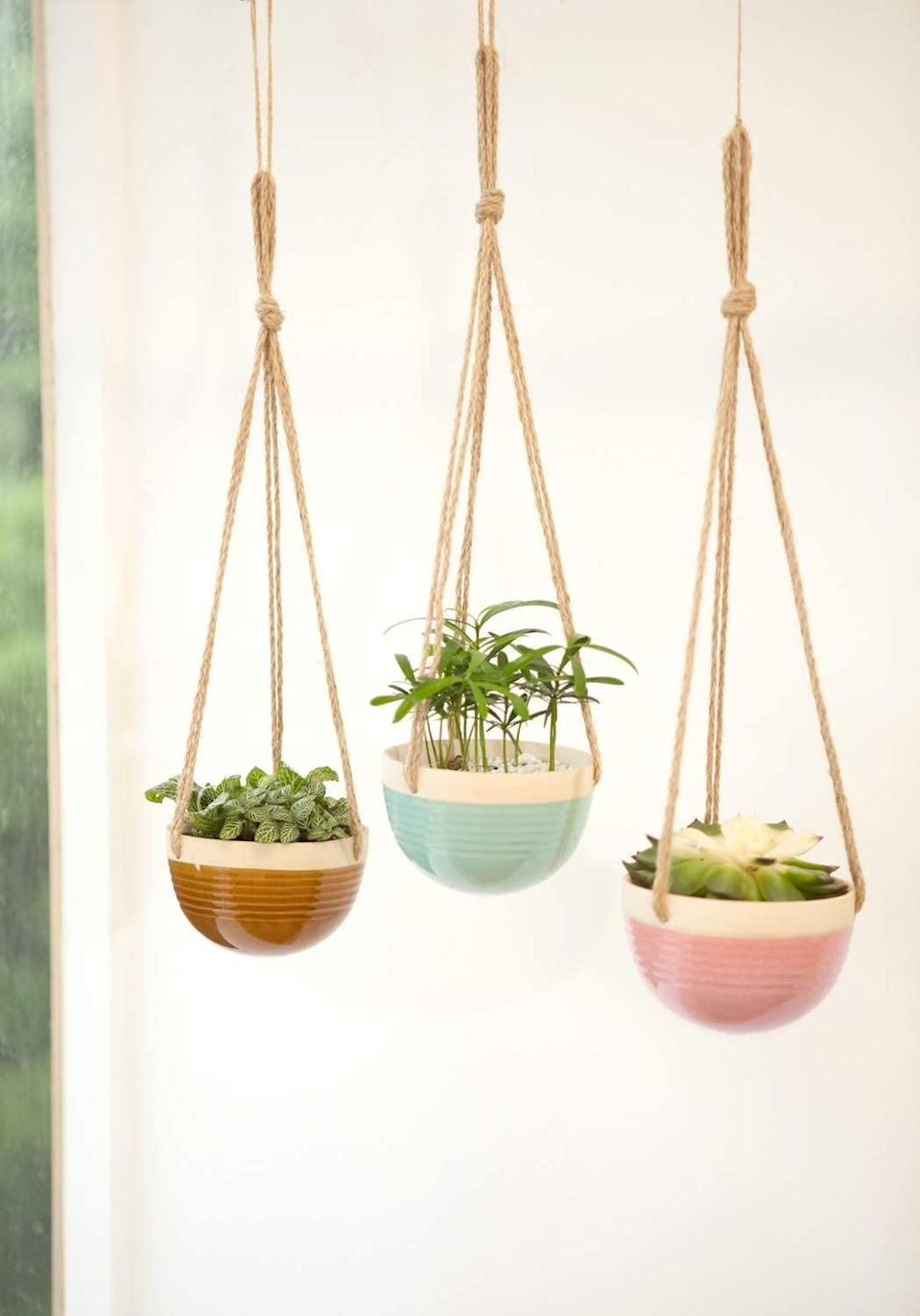 """<h2>Mkono Ceramic Hanging Planter Trio</h2> <br>This sweet trio of color-popped ceramic planters hanging from simple jute ropes is ready to brighten up a kitchen to living room or bedside corner. <br><br><strong>Mkono</strong> Ceramic Hanging Planters, 3-Pack, $, available at <a href=""""https://amzn.to/2JeGKfh"""" rel=""""nofollow noopener"""" target=""""_blank"""" data-ylk=""""slk:Amazon"""" class=""""link rapid-noclick-resp"""">Amazon</a><br>"""