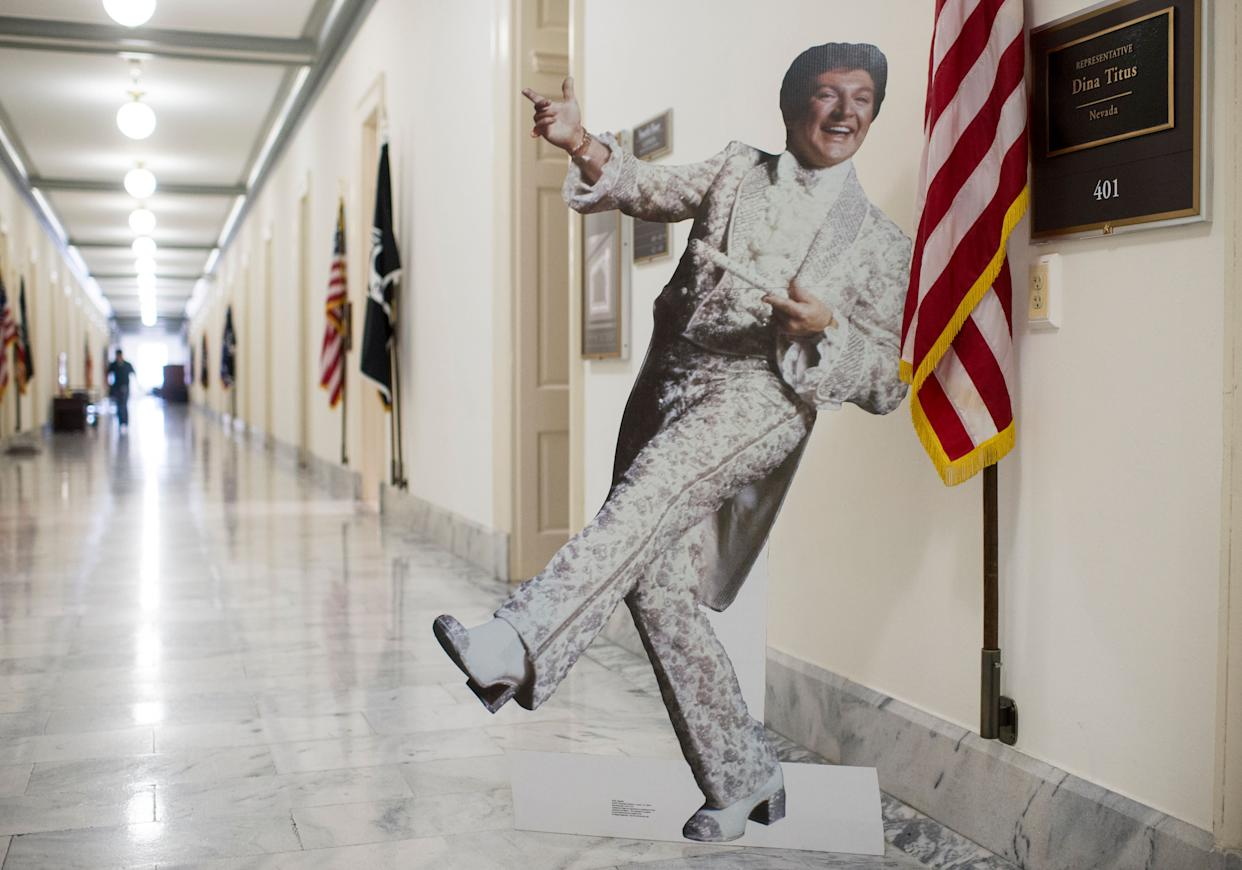 A cardboard cutout of Las Vegas star Liberace stands outside the office of Rep. Dina Titus (D-Nev.) in the Cannon House Office Building on Feb. 18, 2015.