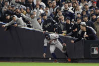 New York Yankees fans react as Houston Astros right fielder Josh Reddick (22) fields a ground rule double hit by New York Yankees' DJ LeMahieu during the sixth inning of Game 4 of baseball's American League Championship Series, Thursday, Oct. 17, 2019, in New York. (AP Photo/Frank Franklin II)