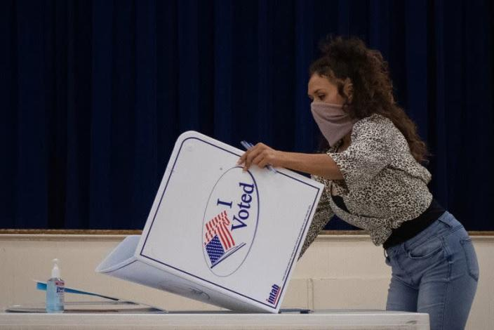 FILE PHOTO: Presidio County election judge folds booth after voting ended for the general election in Marfa, Texas