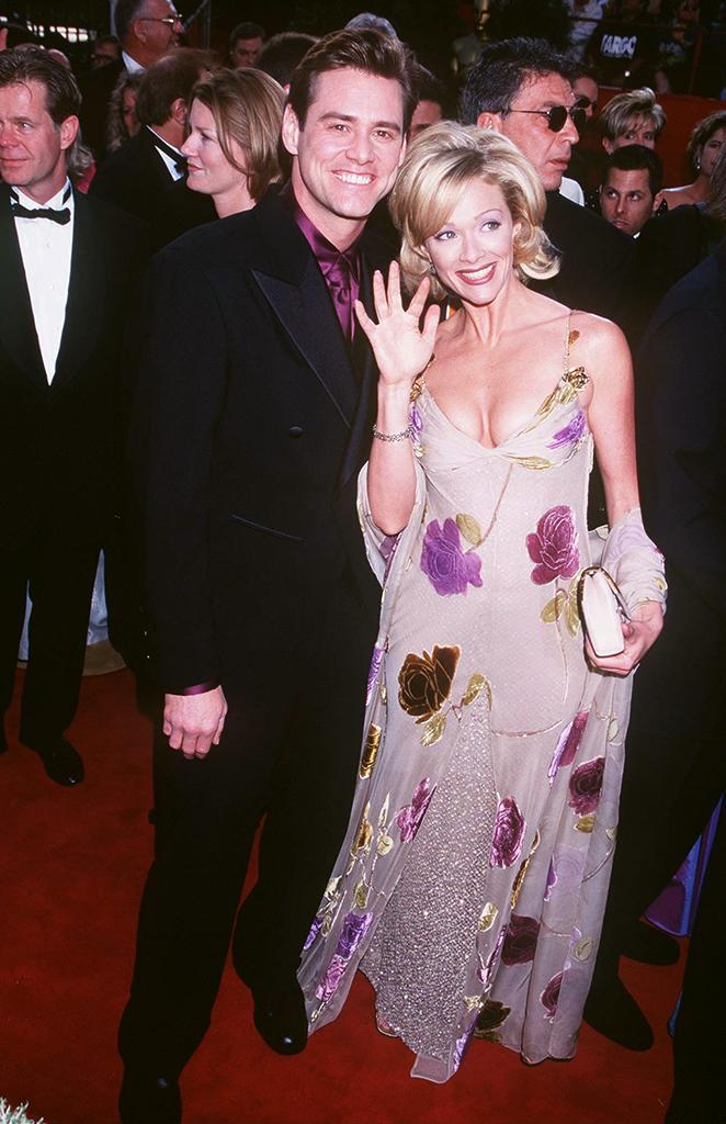 <p>Then-spouses and 'Dumb and Dumber' co-stars pose on the red carpet. (Photo: Jeffrey Mayer/WireImage) </p>