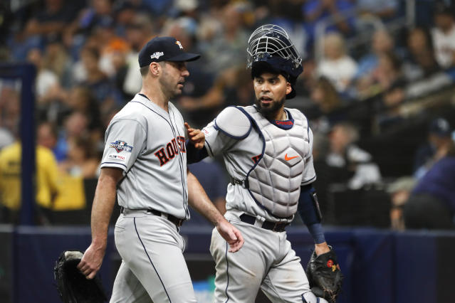 Houston Astros starting pitcher Justin Verlander, left, walks off the field with catcher Robinson Chirinos during the third inning of Game 4 of a baseball American League Division Series against the Tampa Bay Rays, Tuesday, Oct. 8, 2019, in St. Petersburg, Fla. (AP Photo/Scott Audette)
