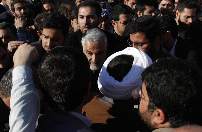Iranian commander General Qassem Suleimani (C), who has been advising Iraqi military leaders fighting Islamic jihadists, attends the funeral of Brigadier General Hamid Taghavi in the Iranian city of Ahvaz on December 30, 2014