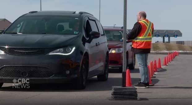 A driver undergoes screening on the P.E.I. side of Confederation Bridge in June 2020.