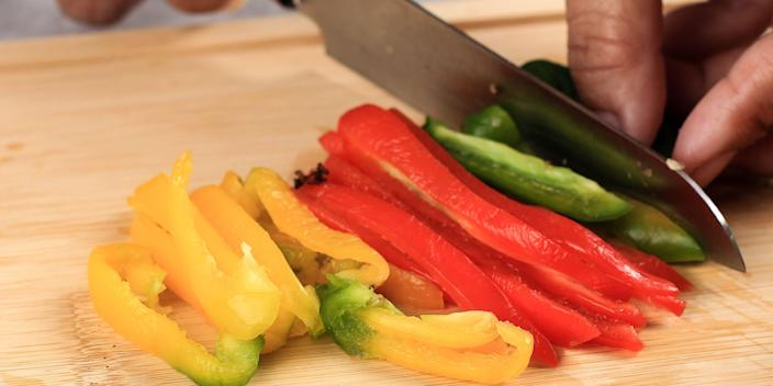 chopping peppers vegetables
