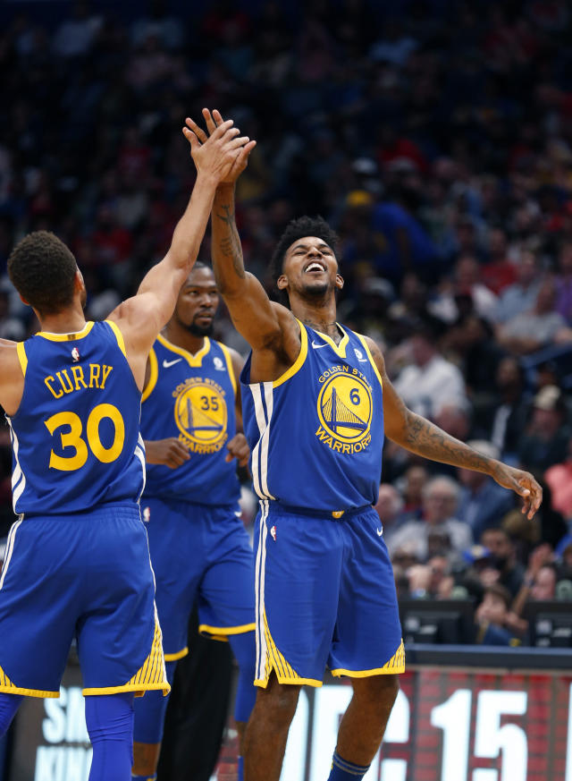 Golden State Warriors guard Nick Young (6) celebrates his 3-point basket with guard Stephen Curry (30) in the second half of an NBA basketball game against the New Orleans Pelicans in New Orleans, Monday, Dec. 4, 2017. (AP Photo/Gerald Herbert)