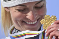 Switzerland's Lara Gut-Behrami eyes her gold medal after a women's giant slalom, at the alpine ski World Championships, in Cortina d'Ampezzo, Italy, Thursday, Feb. 18, 2021. (AP Photo/Marco Tacca)