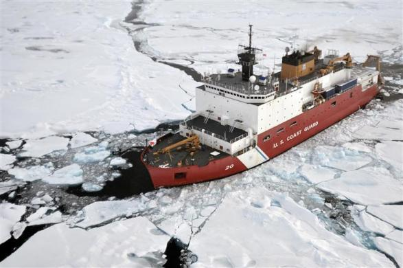 The Coast Guard Cutter Healy breaks ice ahead of the Canadian Coast Guard Ship Louis S. St-Laurent (not seen) during an Arctic expedition in this August 31, 2009 handout photo.