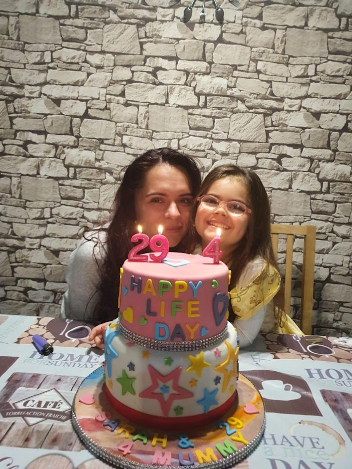 Since having gene therapy, Sarah (pictured with her mother Maria) 'can do everything a normal child her age would do'. (Supplied: Great Ormond Street Hospital)