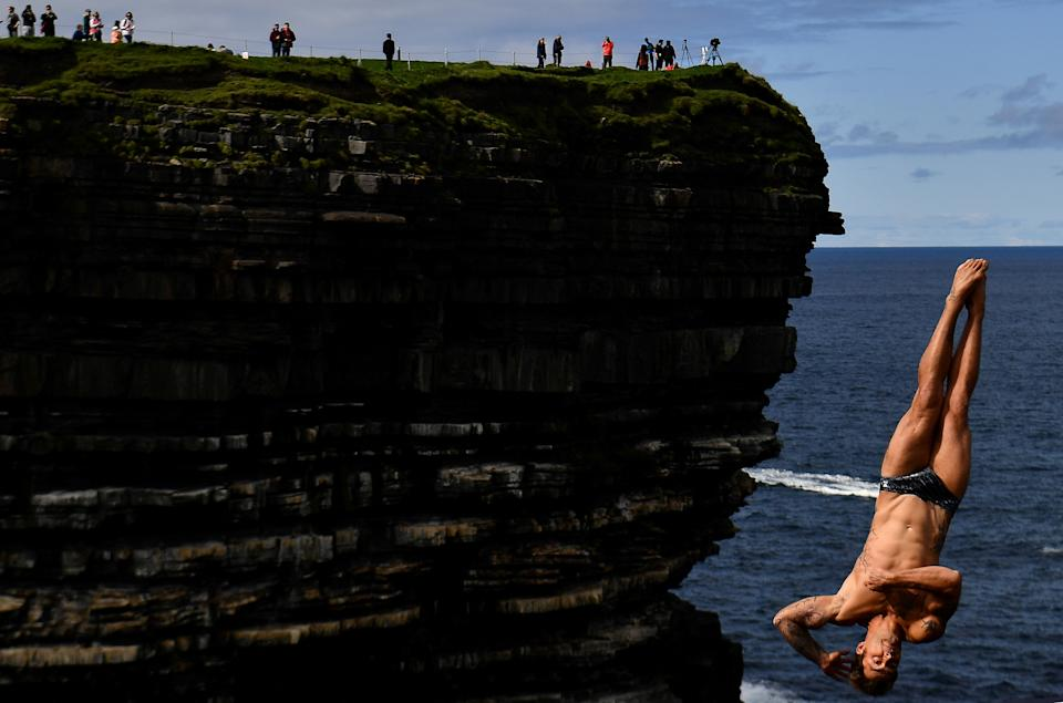 Alessandro De Rose of Italy dives during the 2021 Cliff Diving World Series in Downpatrick Head, Ireland, September 12, 2021. REUTERS/Clodagh Kilcoyne     TPX IMAGES OF THE DAY