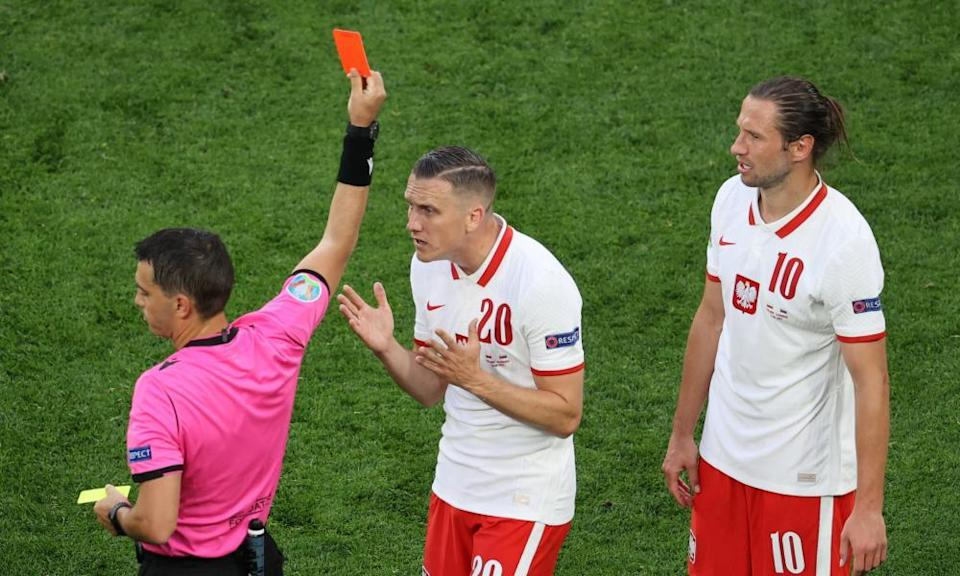 Poland's Grzegorz Krychowiak (right) is sent off in the second half.