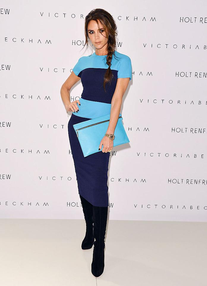 "Last weekend, Victoria Beckham was in Vancouver to present her Fall 2012 collection to Canadian fans and fashion buyers. Naturally, the former Spice Girl and current style icon was decked out in her own designer threads as she sashayed into high-end department store Holt Renfrew. For the occasion, VB paired her $2,300 color-blocked frock with a matching $650 leather clutch and suede Christian Louboutin boots. And what about that mane, a purposely-messy, side-swept braid? We love it, but should she lose it? (6/15/2012)<br><br><a target=""_blank"" href=""http://bit.ly/lifeontheMlist"">Follow 2 Hot 2 Handle creator, Matt Whitfield, on Twitter!</a>"