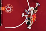<p>Spain's Laura Gil (in red) fights for the ball with South Korean players in the women's preliminary round group A basketball match between South Korea and Spain during the Tokyo 2020 Olympic Games at the Saitama Super Arena in Saitama on July 26, 2021. (Photo by Brian SNYDER / various sources / AFP)</p>